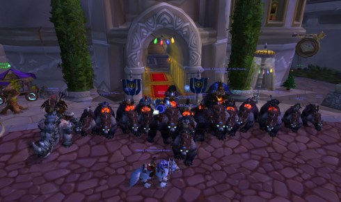 Group of Horde toons riding warbears in front of the Alliance Inn in Dalaran.