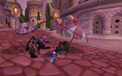 Mishaweha sits with others (including Alliance) in Dalaran, around picnic blankets.